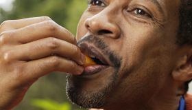 Man putting food into his mouth with his hands