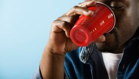 A man drinking from red plastic cup