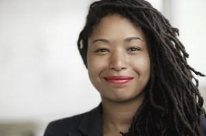 A portrait of a confident businesswoman with beautiful dreadlocks