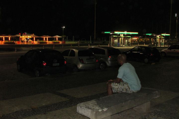 Casey Frost on a bench across the street from Copacabana Beach