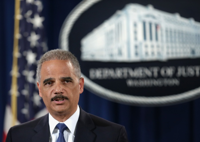Attorney General Holder And IRS Officials Announce Criminal Charges Against Credit Suisse