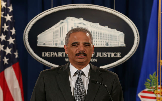 U.S. Attorney General Eric Holder speaks at the Justice Department December 3, 2014 in Washington, DC. Holder spoke about the recent decision by a Staten Island grand jury not to indict a police officer in the chokehold death of Eric Garner. (Photo by Mark Wilson/Getty Images)