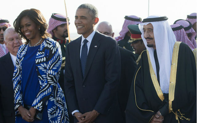 Saudi new King Salman  walks alongside President Barack Obama and first lady Michelle Obama after the Obamas arrived on Air Force One at King Khalid International Airport in Riyadh on January 27, 2015. Obama landed in Saudi Arabia to shore up ties with new King Salman and offer condolences after the death of his predecessor Abdullah.   (SAUL LOEB/AFP/Getty Images)