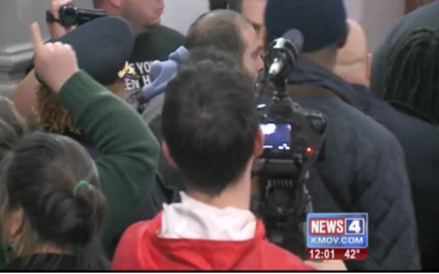 Witnesses say chaos erupted at St. Louis City Hall when a woman was pushed by a leader of the police union. (YouTube Screenshot)