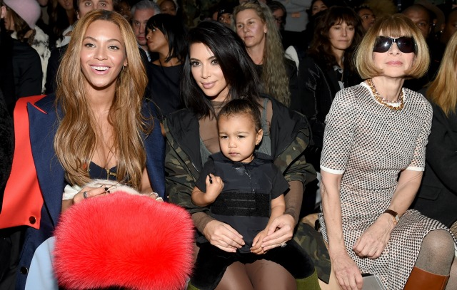 (L-R) Beyonce, Kim Kardashian with daughter North and Anna Wintour attend the adidas Originals x Kanye West YEEZY SEASON 1 fashion show during New York Fashion Week Fall 2015 at Skylight Clarkson Sq on February 12, 2015 in New York City. (Photo by Dimitrios Kambouris/Getty Images for adidas)