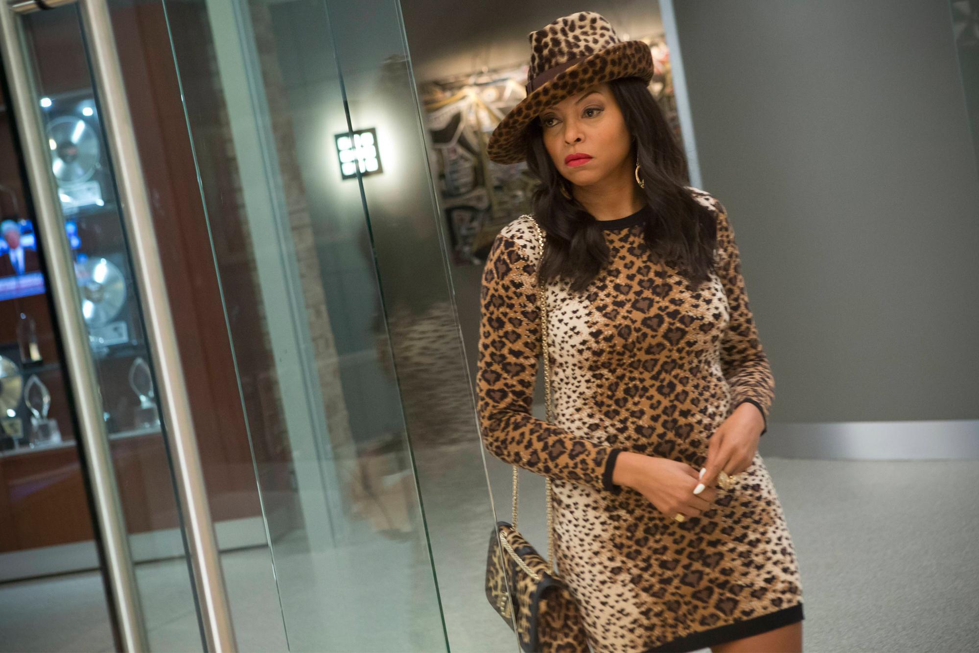 Fresh out of jail, she sports a knee-length leopard print dress. (Chuck Hodes/Fox)