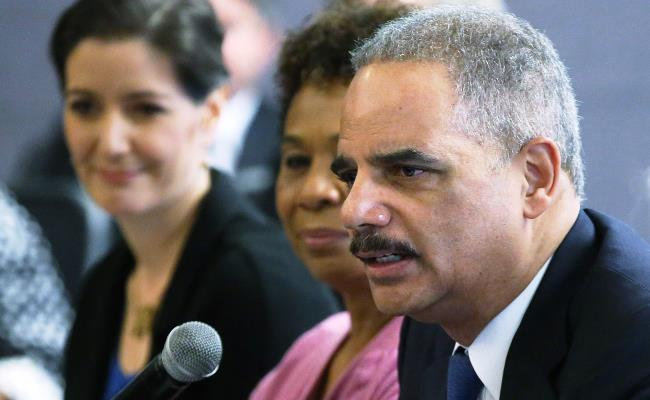 U.S. Attorney General Eric Holder (foreground) speaks during a Building Community Trust roundtable meeting on February 5, 2015 in Oakland, California.  Shown behind him is Rep. Barbara Lee (D, Calif.) (Justin Sullivan/Getty Images)