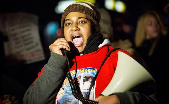 Erica Garner, daughter of Eric Garner, leads a march of people protesting the Staten Island, New York grand jury's decision not to indict a police officer involved in the chokehold death of Eric Garner in July, on December 11, 2014 in the Staten Island Neighborhood of New York City. (Andrew Burton/Getty Images)