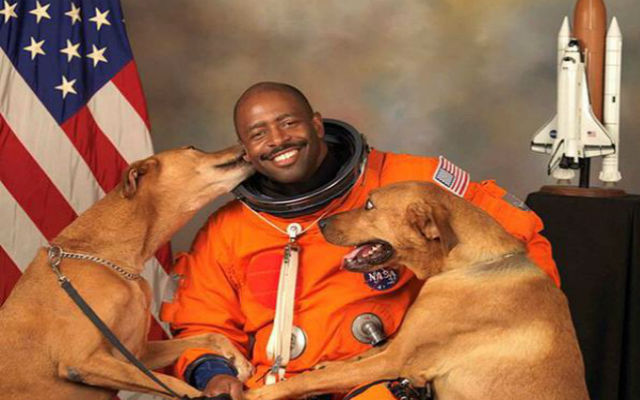 Retired NASA astronaut Leland Melvin and his dogs, Jake and Scout, in his official portrait. (Twitter)