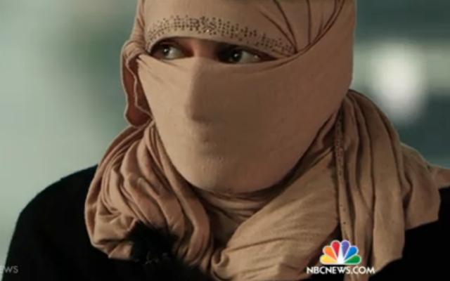 Farida, a 19-year-old escaped ISIS captive, recounts the horrors of slave auction. (NBC News Screenshot)