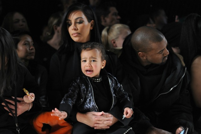 FEBRUARY 14: (L-R) Kim Kardashian, North West and Kanye West attend the Alexander Wang Fashion Show during Mercedes-Benz Fashion Week Fall 2015 at Pier 94 on February 14, 2015 in New York City. (Photo by Craig Barritt/Getty Images)