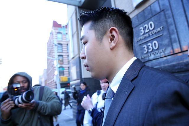 New York City police officer Peter Liang is escorted out of court after he was charged with manslaughter, official misconduct and other offenses on February 11, 2015 in the Brooklyn borough of New York City. Liang pleaded not guilty Wednesday in the November 20 death of 28-year-old Akai Gurley. Liang claims he fired his gun accidentally in a stairwell in the Pink Houses, a public housing complex in East New York. Liang was released without bail. The Brooklyn courtroom was packed with officers and protesters.