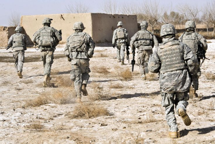 U.S. Army soldiers respond to a small arms attack in Badula Qulp, Afghanistan.