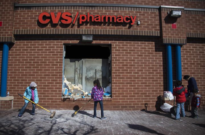 Volunteers clean up the looted CVS in Baltimore.