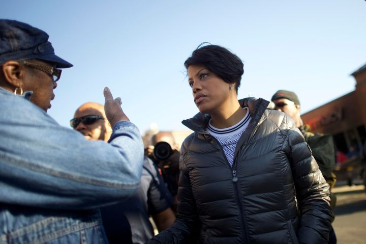 Mayor Stephanie Rawlings-Blake talks to civilians after Monday's riots.