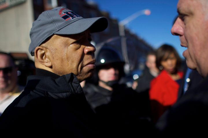 Congressman Elijah Cummings listens to people on the street Tuesday morning in Baltimore.