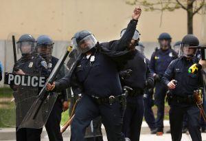 Baltimore police throw rocks