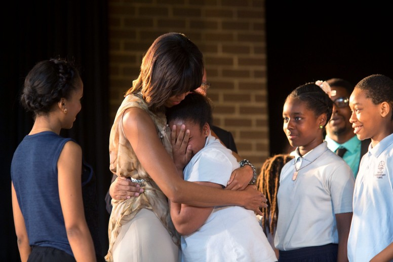 Michelle Obama greeting students with Kerry Washington after their performance at Savoy Elementary School in Washington, D.C.