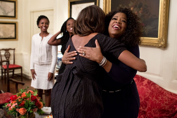 Michelle Obama greeting Oprah Winfrey and others at the White Hous