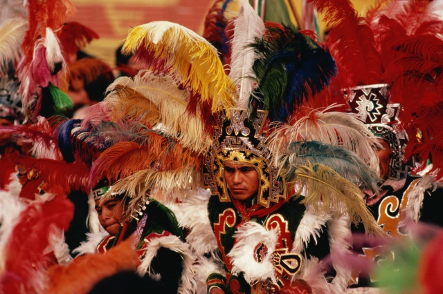 Mexico,Mexico City,Apache dancers performing in Aztec costumes