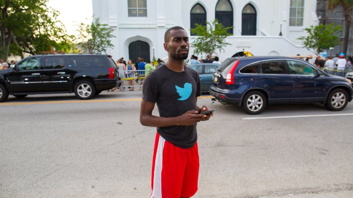 Activist DeRay McKesson is seen outside of Emanuel AME church.