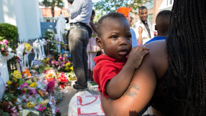 A mother and son surround a memorial for the nine church members killed during the Charleston shooting.