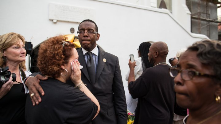 Church members comfort one another after Emanuel's first service since the Charleston shooting.
