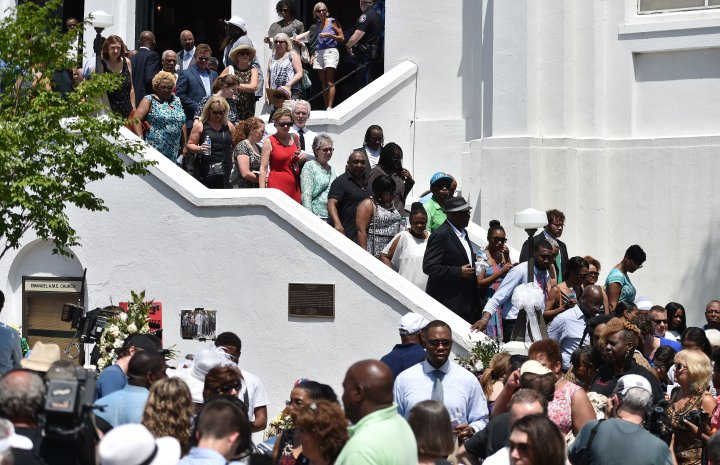 The congregation departs following Sunday services at the Emanuel AME Church in Charleston, South Carolina.