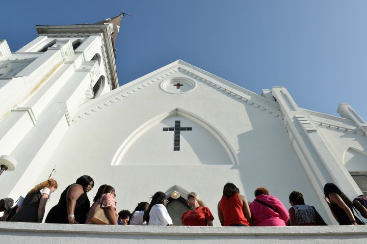 People line up to enter for Sunday service at the Emanuel AME Church.