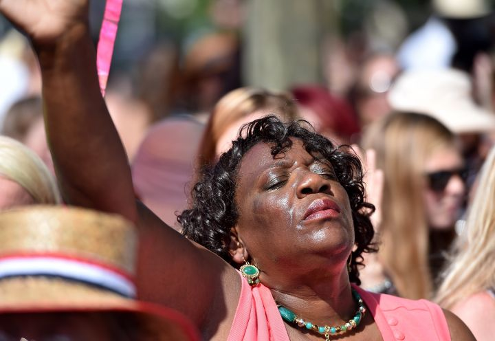 A woman prays as she attends the Sunday service outside of the Emanuel AME Church.