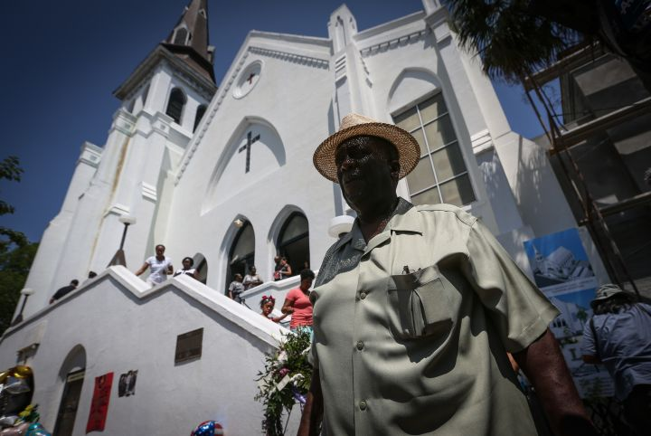 A member of the church is seen outside of Emanuel AME before its first service since the Charleston shooting.