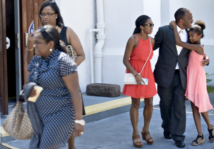 A family is seen leaving Emanuel AME Church following Sunday services.
