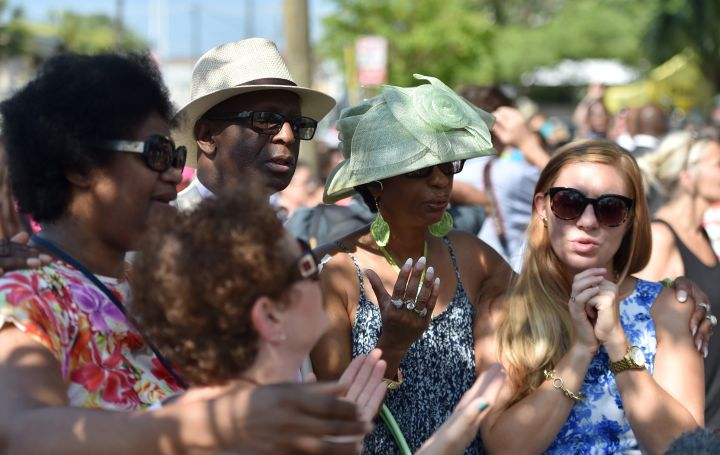 People pray and listen to the Sunday service outside of the Emanuel AME Church in Charleston, South Carolina.