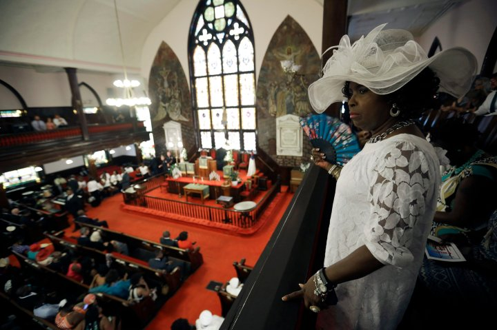 Gloria Moore watches the church as parishioners take their seats at the Emanuel AME Church.