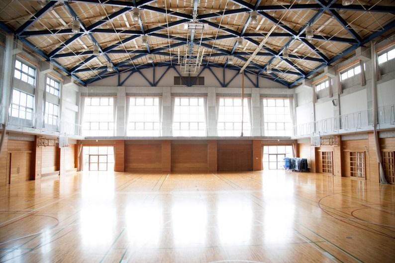 Japanese high school. An empty school gymnasium. Basketball court markings