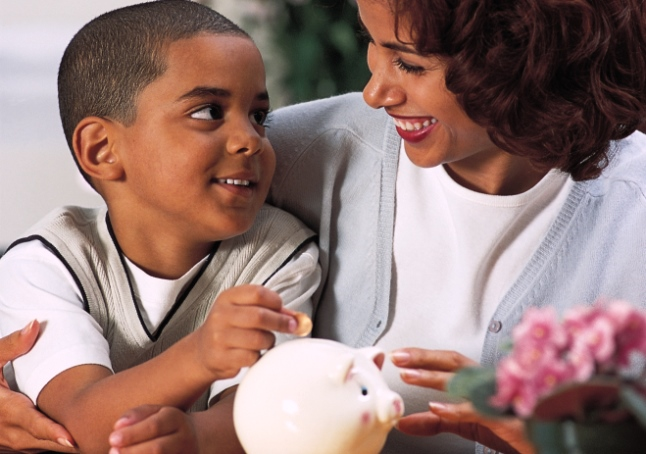 Mother and son with piggy bank