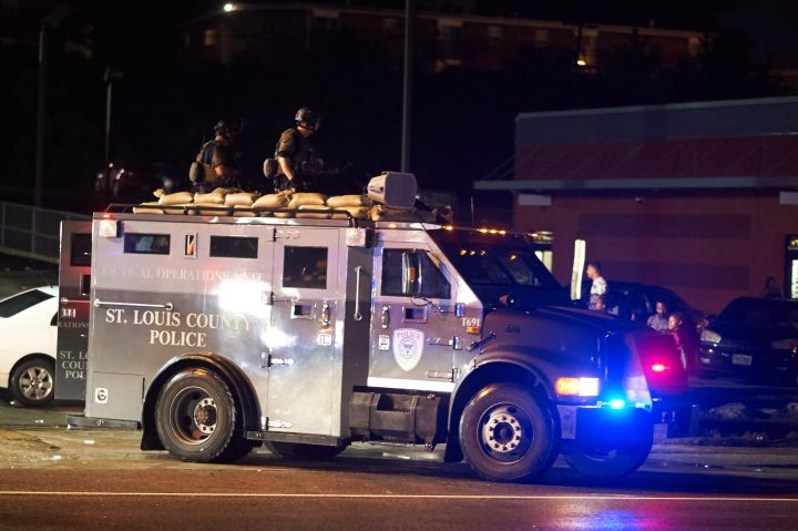 2015: St. Louis police with army gear arrive in Ferguson Sunday night.