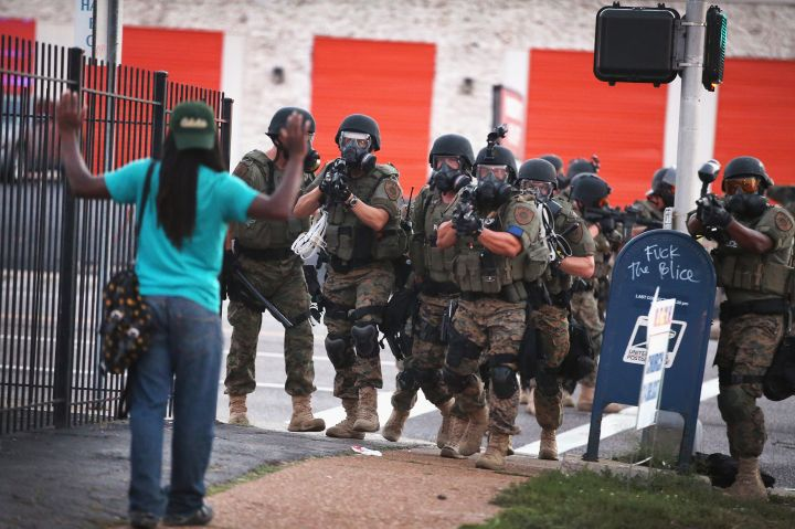 2014: An unarmed protester was approached by police during protests in Ferguson. The image became one of the most memorable of the city's uprising.
