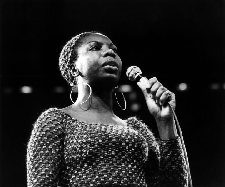 """Nina Simone: Accomplished pianist, singer, songwriter and activist Nina Simone stayed true to her self throughout her career. She was beloved in the soul and blues realms, although she wanted to be seen as a folk singer. She drew inspiration from her time at Julliard and performed in jazz and soul clubs. In the 1950's the singer released her full length album and reached Top 40 status. In that time, she also became close to the civil rights movement. Her release of """"Mississippi Goddam,"""" helped paint a soundtrack to the movement. The song was inspired by the 1963 assassination of Medgar Evers and the Birmingham church bombing that killed four African-American girls. Her connection to the movement caused her to be blacklisted in Hollywood and criticized by her own husband, who was her manager. After finding continued fame overseas, the singer released more music to her own liking and returned to the states to perform a handful of times. Her story was told in the recent documentary """"What Happened, Miss Simone?"""" unveiling her abusive past with her husband and troubles after her affiliation to the civil rights movement."""