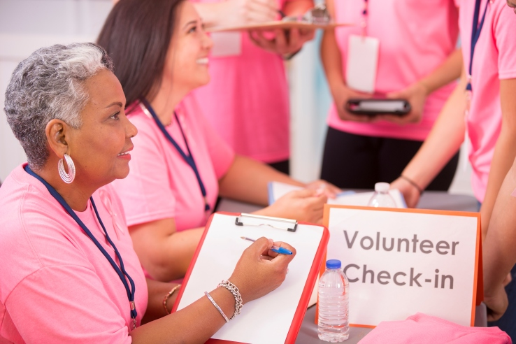 Breast Cancer Awareness volunteers sign up for local event.