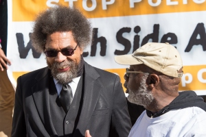 Carl Dix (right) introduces Dr. Cornel West at the press...