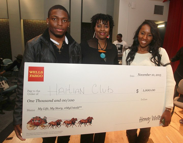 Wells Fargo awards the Spelman College Haitian Club $1,000 to fund community initiatives during the My Life, My Story, #MyUntold℠ Town Hall on November 10, 2015 at the Atlanta University Center Consortium. Vice President, African American segment manager for Wells Fargo, Lisa Frison, presents the check to the organization's leaders.