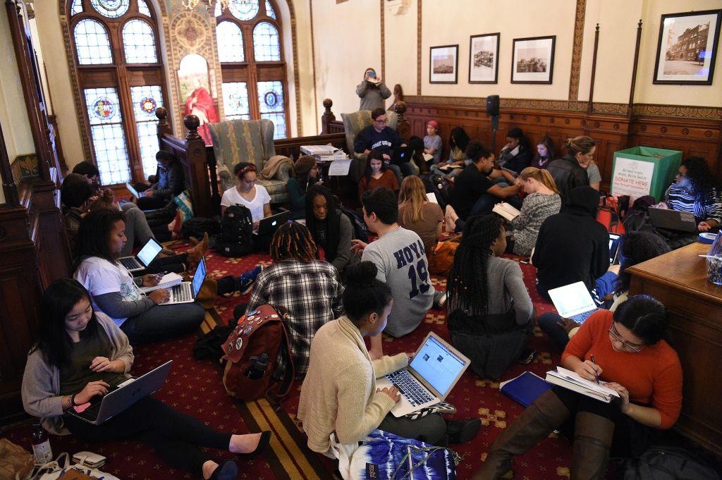 WASHINGTON, DC - NOVEMBER 13: Around 30 students sit in in fron