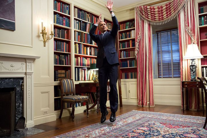 FEBRUARY: President Barack Obama fakes a jump shot during an Affordable Care Act video taping for BuzzFeed in the White House Library. The video went viral thanks to jokes about his presidency and ultra-cool swag.