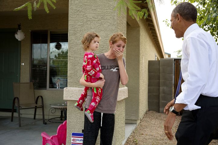 JANUARY: President Barack Obama greets neighbors after visiting a model home at the Nueva Villas at Beverly, a single-family housing development owned by local nonprofit organization Chicanos Por La Causa Inc. in Phoenix, Ariz.