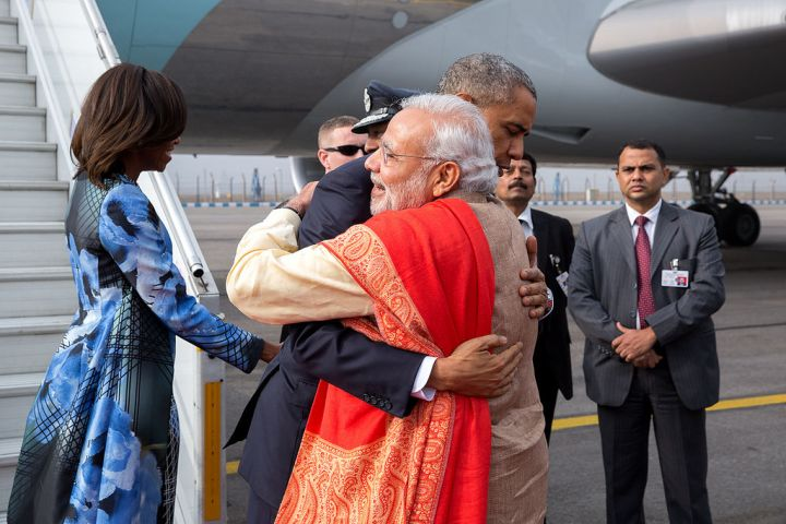 JANUARY: President Obama greets Prime Minister Narendra Modi upon arrival at Air Force Station Palam in New Delhi, India.
