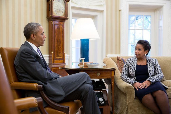 APRIL: Obama speaks with newly appointed Attorney General Loretta Lynch in the Oval Office.