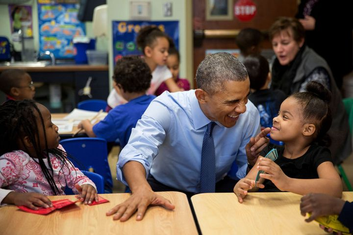 JANUARY: President Barack Obama has an adorable moment with Akira Cooper at the Community Children's Center, one of the nation's oldest Head Start providers, in Lawrence, Kan.