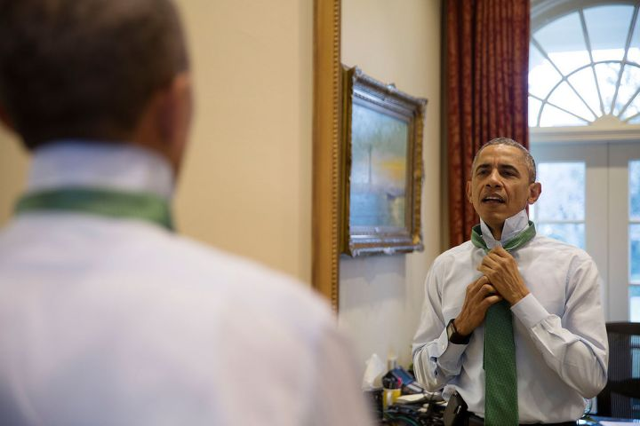 MARCH: Obama is a classic man as he puts on a green tie in observance of St. Patrick's Day.