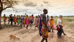 Tourists walk with Masai villagers